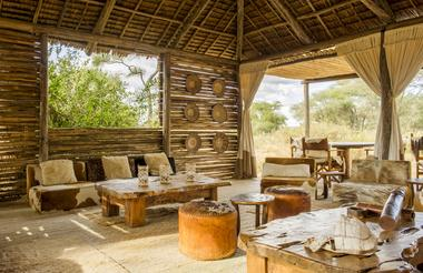 The sun-slatted main mess area at Kuro is a comfortable spot to curl up with some binos and a good book in between forays into the wilds of Tarangire.